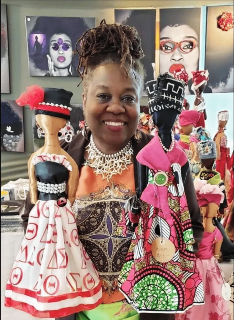 woman with crafted dolls
